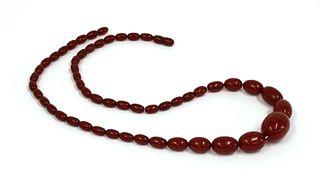 A single row graduated cherry coloured Bakelite bead necklace,