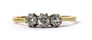 A gold three stone diamond ring,