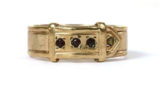 A 9ct gold garnet set buckle ring,