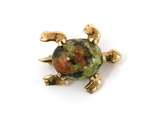 A gold tortoise brooch,