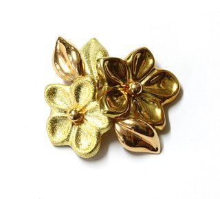 An Italian two colour gold flower brooch,