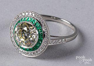 Platinum, diamond, and emerald ring