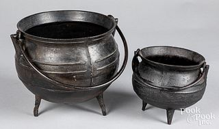 Two cast iron gypsy kettles, 18th/19th c.
