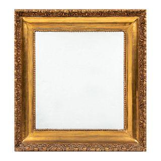 Espejo. SXX. Luna cuadrangular. Luna rectangular y marco de madera dorada. 54 x 52 cm (medidas con marco).