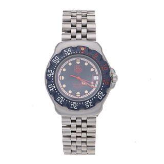 Reloj Tag Heuer Professional. Movimiento de cuarzo. Caja circular en acero de 33 mm. Carátula color azul con índices de puntos...