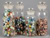 Four glass bottles with antique marbles