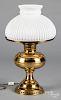 Brass fluid lamp, with a milk glass shade.