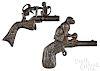 Two cast iron animated monkey cap guns