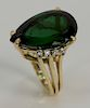 14 karat gold ring, set with large pear shaped green tourmaline, approximately 22 cts., flanked by eight brilliant cut diamonds. siz...