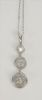Platinum pendant, set with three diamonds in circles, .48 cts., .45 cts., and .37 cts. pendant: height 1 3/8 inch