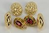 Three pairs of 18 karat gold earrings to include two pierced and one ear clip, one pair set with red stones, and one with small diam...