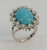 Transformable ring, pendant, brooch, having a cabochon oval turquoise surrounded by twenty-four diamonds, mounted in 14 karat white ...