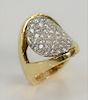 18 karat gold ring set with oval panel of forty diamonds. size 5 1/2, 16 grams total weight