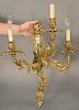 Pair of gilt rococo bronze sconces,  having scrolling three arms with foliate and flower design, wired.  height 28 inches, width 18 ...