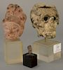 Three early sculptures of busts, iron skulls, stone Chinese bust, and a miniature stone head