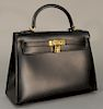 Hermes black leather Kelly bag with gold plated hardware, like new condition with lock key and certificate of authenticity.  height ...