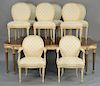 E.J. Victor dining table and eight chairs,  having shaped top on turned and fluted legs, and three dimensional flowers on skirt wi...