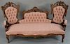 Victorian sofa of laminated rosewood, attributed to Baudoine,  having center north wind face and pierced carved back and sides, all ...