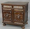 Jacobean oak cabinet with bone inlaid black and white squares and triangles,  two drawers over two doors opening to three fitted dra...