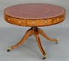 George III mahogany and rosewood drum table, having four drawers, inset leather revolving top on pedestal with four down swept membe...