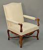 Louis XV fauteuil having off-white walnut frame,  carved hand rests and legs with stretcher base, 18th century.  height 39 1/2 inche...