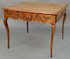 Louis XV fruitwood center table with drawer on either end with floral carved sides, set on delicate cabriole legs, 18th century.  he...