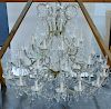 Crystal and brass thirty-seven light chandelier.  height 48 inches, diameter 50 inches