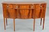 Fineberg Federal style mahogany sideboard with shaped top,  over conforming case of three drawers over four doors, all set on square...