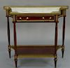 Continental style mahogany stand with marble top,  having brass gallery over one drawer, on turned and fluted legs.  height 32 inche...