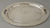 Large oval sterling silver serving tray,  having handles and monogrammed center, marked: sterling 750/87