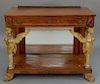 Mahogany pier table with drawer and bronze mounts,  supported by carved and gilt caryatids, having mirrored back, set on base with g...