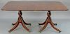"""Custom mahogany two part dining table with double pedestal base and two 17 inch leaves.  height 29 1/2 inches, top closed: 47"""" x 6..."""