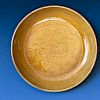 A CHINESE ANTIQUE YELLOW GLAZED DRAGAN PLATE
