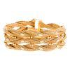 A Ladies Wide Braided Bracelet in 18K Gold