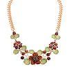 A Ladies Garnet and Enamel Floral Necklace in 14K
