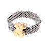 Argolla  en acero y oro amarillo de 18k de la firma Tous. Talla: 7. Peso: 2.8g.