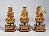 Three Chinese carved and gilt wood Buddhas