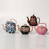Four Earthenware Teapots