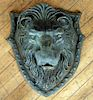 GREEN PAINTED CAST IRON LION ON SHIELD PLAQUE