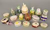 Group of eighteen porcelain trinket pill boxes, Peint Main Limoges, rabbit figural boxes. tallest 4 in. Provenance: From the Estate ...