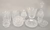 Group of nine Waterford crystal pieces to include two biscuit jars, decanter, vases, etc. ht. 2 1/2 in. to 12 in. Provenance: From t...