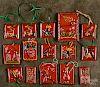 Fifteen Shooner redware Christmas ornaments.