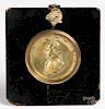Miniature brass plaque of George Washington