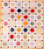 Pieced star in block quilt