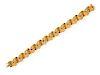 An 18 Karat Yellow Gold and Polychrome Enamel Bracelet,