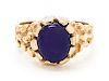 A 14 Karat Yellow Gold and Purple Hardstone Ring,