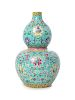 A Turquoise Ground Famille Rose Porcelain Gourd-Form Vase Height 10 3/4 in., 27 cm.