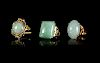 Three Jadeite and 14K Yellow Gold Mounted Rings Largest interior: diam 3/4 in., 2 cm.
