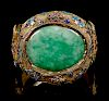 An Apple Green and Pale Celadon Jadeite Inset and Enamel Inlaid Silver-Gilt Filigree Bracelet Width 2 7/8 in., 7 cm.