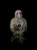 A Carved Silhouette Grey Agate Snuff Bottle Height 2/12 in., 6 cm.
